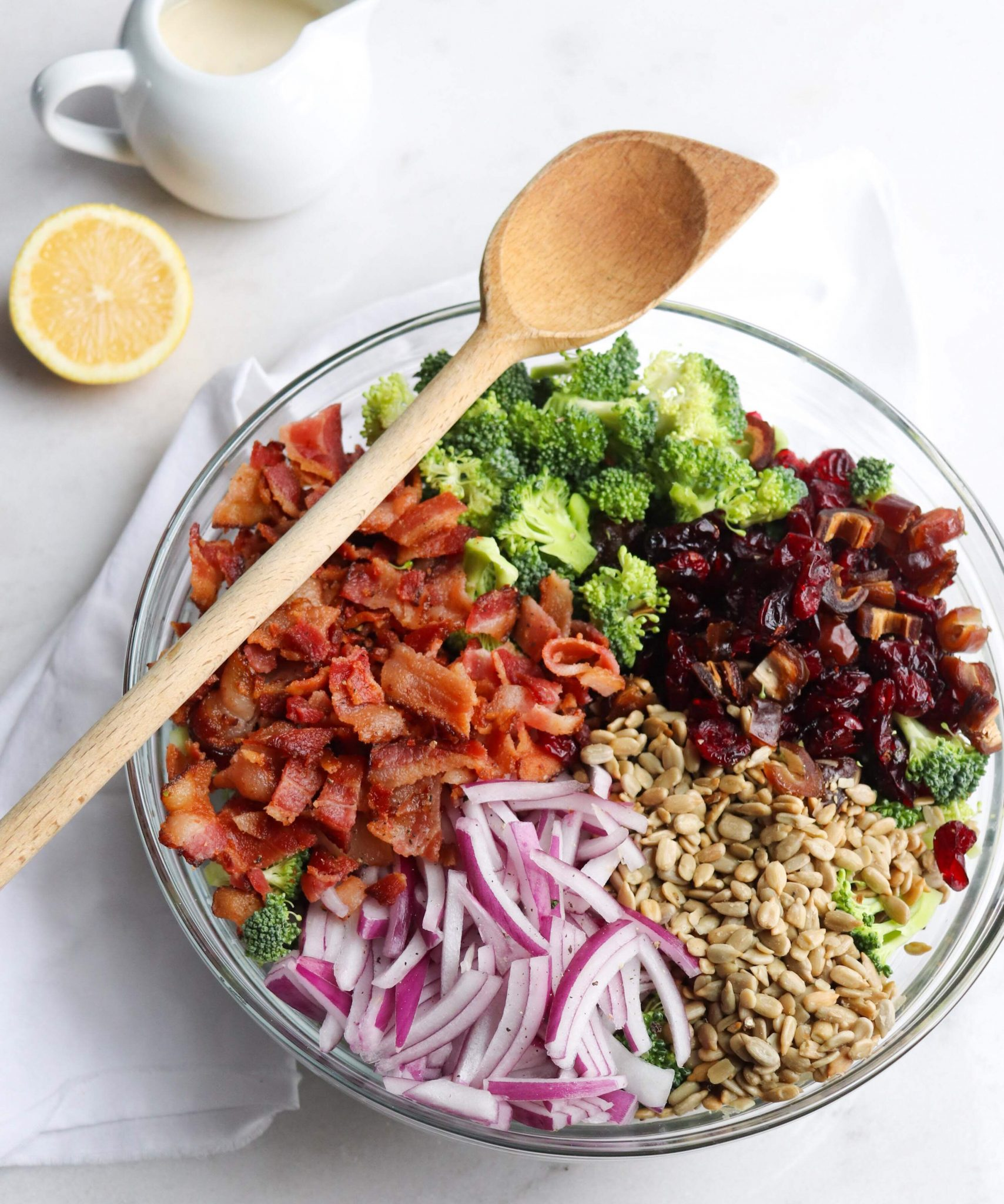 A delicious Whole30 compliant salad made with broccoli, bacon, dates, sunflower seeds and red onion topped with a creamy lemon garlic dressing. *Easy Keto and vegetarian options included