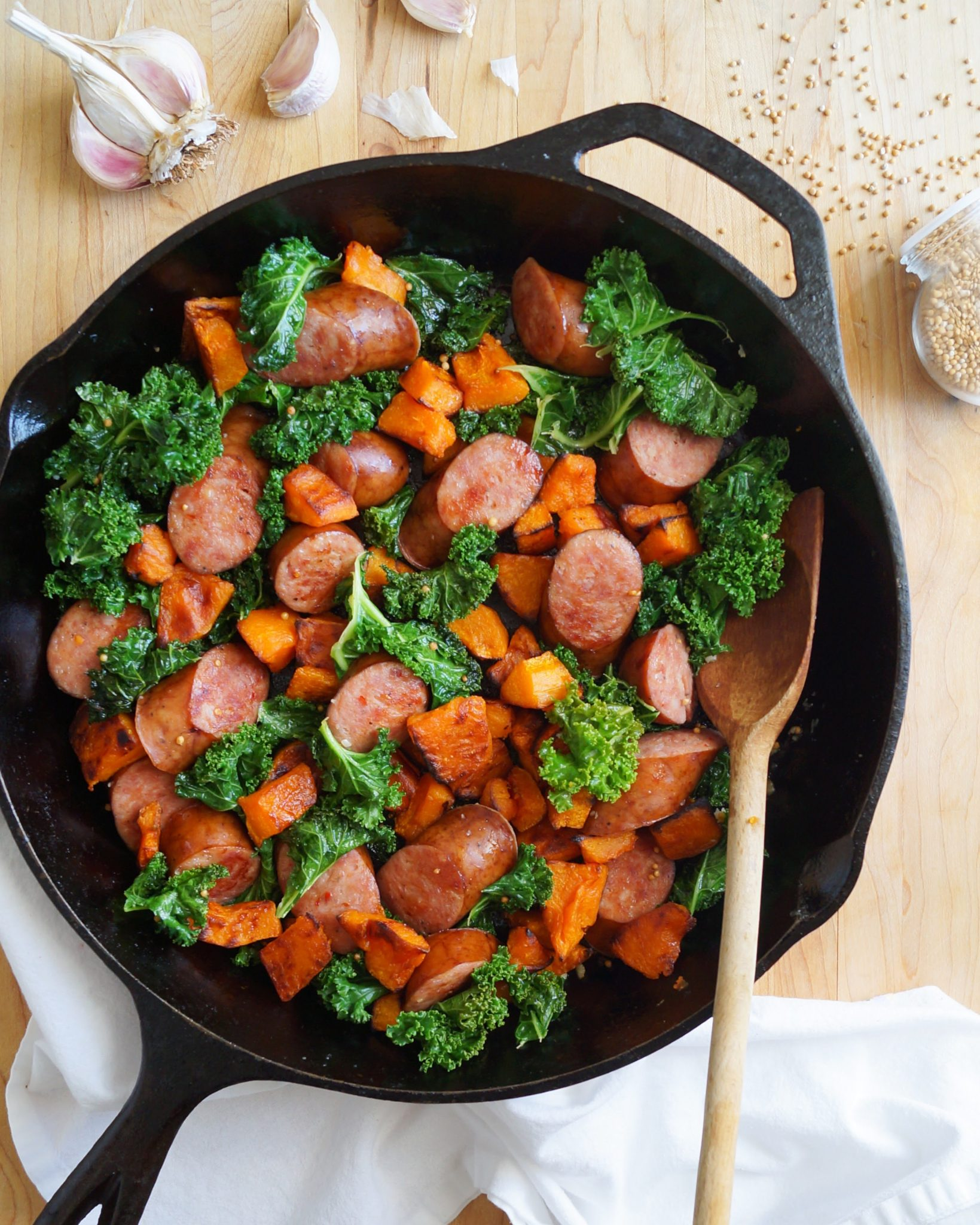 Whole30 & Paleo Sauteed Kielbasa Skillet with butternut squash and kale. It has all the best flavors of fall!