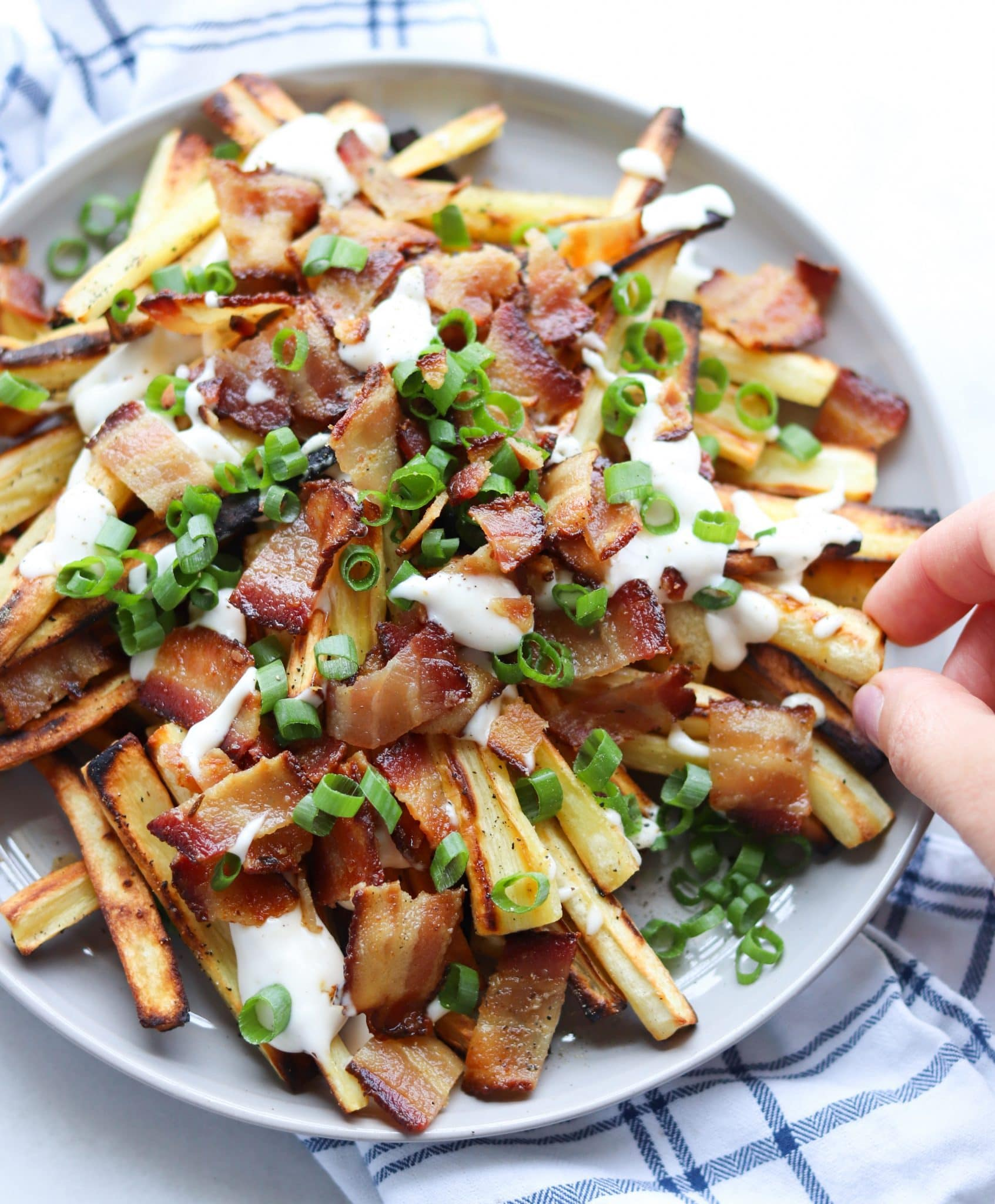 Loaded Roasted Parsnip Fries - Finished Dish on a gray plate with a white napkin beside it.
